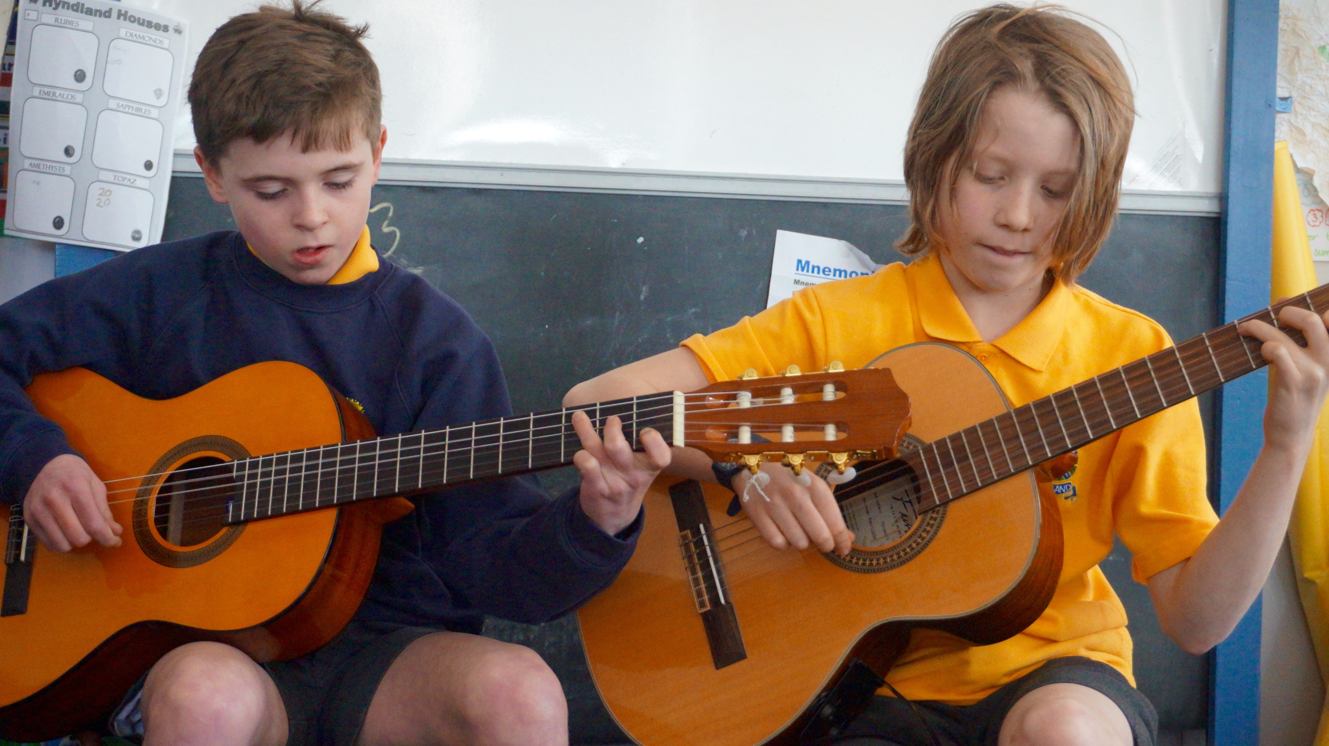 Boys playing guitar